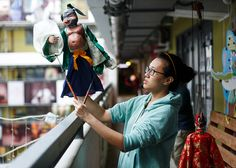 Chinese Puppetry workshops in Hong Kong at the JCCAC (中國偶戲在香港 Sidekick Project). This Michelle Li operating a rod puppet. http://houlker.co.uk/theatre/photographing-puppetry/