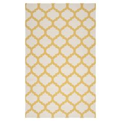 Anchor your living room seating group or define space in the den with this artfully hand-woven wool rug, showcasing a quatrefoil trellis motif for eye-catchi...