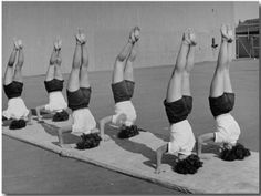 Vintage yoga exercise headstands Loved and pinned by www.downdogboutique.com