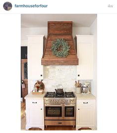 """""""I love how @farmhouseforfour covered her hood for her range vent in wood.  I think I've showed this image to my husband at least 100 times...…"""""""