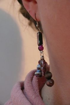 How to make some cute purple dangly earrings under 30 minutes. This is an easy way for anyone who wants some cute new earrings. See the blog for a step-by-step tutorial.