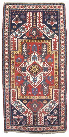 """Kasim Ushag, 19th C (4th Q),  Caucasus - The medallion format of this colorful Kasim Ushag rug from the Karabagh region beautifully & accurately preserves designs first articulated in classical Caucasian embroideries of the 16th & 17th centuries. Geometrically abstracted networks of tendrils, composed of latch-hooks, diamonds, & stars are drawn throughout the field with branches emanating from the central ivory medallion. W :3' 9"""" x L :7' 3"""""""