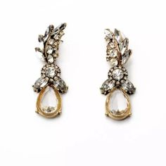 Crystal Feather Earrings Jewelry These earrings are a brand new retail item! We only use the highest quality crystals & stones for all of our jewelry, giving our pieces lots of sparkle and an expensive look! Every piece has been given the upmost time and care when created and has been made and designed with quality and durability in mind. Every piece is nickel and lead free. Almost every item is an exclusive item; meaning once sold its gone for good. Jewelry Earrings