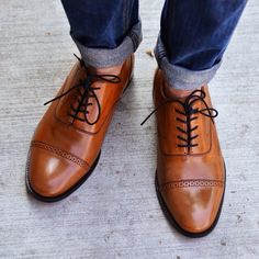 Nice shoes with rolled-up jeans