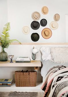 """Hana Waxman chose to work with all local materials, even the furniture and textiles are locally sourced: antiques from Mexico City, furniture from San Miguel de Allende, textiles from Oaxaca. """"Everything is clean, simple, and very shacky,"""" she says. """"We keep surfboards in the house and have a hammock in our living room. Nothing about our home is formal.""""Whether you set out to or not, sun hats are something that seem to accumulate when you live in a tropical setting."""