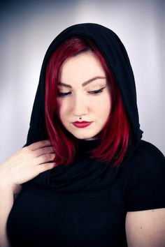 Beautiful underground girl with red hair and medusa piercing wearign Yggdrazil's top. This top with short sleeves has a cowl neckline, large enough to put as hood ▲◊↕◊▲ Toonzshop is a trip in an Alternative Universe of independent artists, brands and designers.