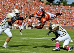 Clemson wide receiver Sammy Watkins dives between Georgia Tech defenders Daniel Drummond, left, and Louis Young to the 1-yard line. Watkins finished with 42 yards receiving after missing last week's game. (AP Photo/ Richard Shiro)