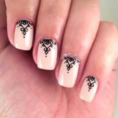 Neutral nails with black filigree accents.