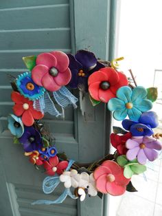 handmade wreath with polymer clay flowers (diameter 20 cm) information asimi kai fos:elmousou@live.com
