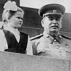 Stalin on the platform of the mausoleum in the day May Day demonstration in 1952. student of 1st class 612 schools in Moscow Vera Kondakova warmly welcomes of Joseph Stalin after receiving a bouquet.