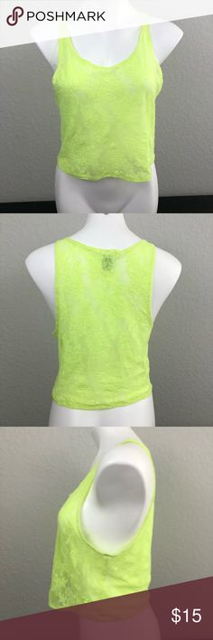 PINK Victoria's Secret Neon Lace Crop Top Neon green lace see thru Crop Top, green embroidered dog emblem on lower front hem, good condition. Show off cute side boob this summer! PINK Victoria's Secret Tops Crop Tops