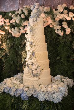 We'll be thinking of this nine-tier cake from A&M Designs for a very long time. Jewel Tone Colors, Different Shades Of Green, Tier Cake, May Weddings, Bridesmaid Makeup, Blue Hydrangea, Sugar Flowers, Silver Dollar, Reception Decorations
