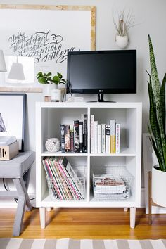 3 Ways to Style and Use Ikea's Kallax (Expedit) Shelf #theeverygirl - affordable media stand
