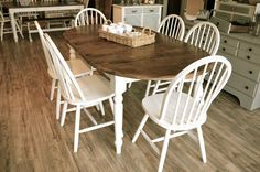 """Distressed Off White Dining Set Set: 1 Table , 1 extension leaf, and 6 chairs Just refinished, distressed antique white and medium brown top. Table Dimensions without leaves extension : 54""""W 42""""D 29.5"""