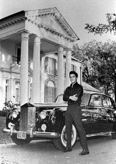 Elvis in front of Graceland leaning on car