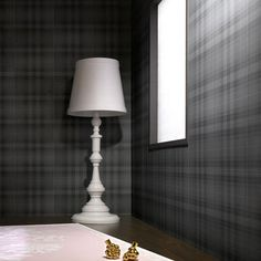 Audrey is a subtle tartan wallpaper. The design itself harks back to a long lineage of classic designs (although the tartan itself is an original, by the celebrated Marcel Wanders) and the smoky grey tones add a touch of modern sophistication. It's more than you might expect from an ordinary check wallpaper. The colouring is also very practical and will hide smudges. As such it's ideal for workspaces