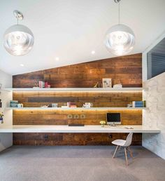 This midcentury home office by Lake Oswego Design-Build Firms Vanillawood is an incredible space to be creative and productive.