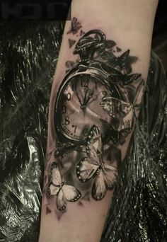 Butterflies And Clock Tattoo On Arm