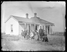 Family in front of a farmhouse in Custer County, Nebraska. 1888