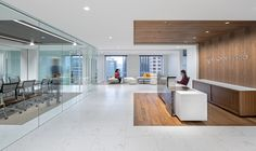 Wood detailing in the reception area of Korn Ferry's San Francisco office runs…