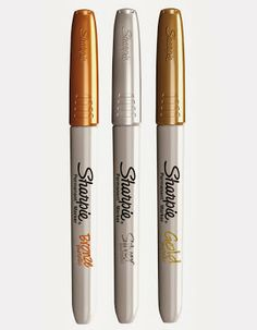 use the metallic Sharpie markers in gold, silver and bronze. They are also easier to use than the nail art brush...tips given for this art