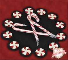 "Wool Candlemat Kit - Peppermint Twist: Create a beautiful candlemat for your holiday decor with this wool applique kit! Includes 100% pure hand-dyed wool, backing fabric, and instructions to create the 12"" diameter mat."