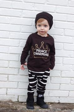 PRINCE CHARMING  Some day my prince will come Some day Ill find my love And how thrilling that moment will be When the prince of my dreams comes to me - Someday My Prince Will Come This Prince Charming onesie or tee features a modern gold crown sillhouette with the words Prince Charming written in a Disney inspired font. Black tees will feature a white font with gold crown. A perfect tee for any little prince to wear for a trip to Disney, a Prince and Pincess party or any day!  I love custom…