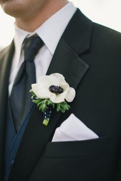 white anemone boutonniere - Fairmont San Francisco Wedding captured by Delbarr Moradi - via ruffled