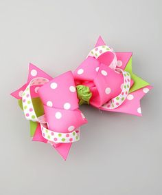 Add some cheer to any hairdo with this festive accessory. Made of ribbon with a sturdy alligator clip base, this piece promises to stay in place.