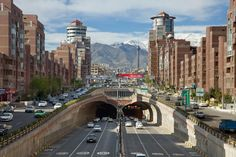 TEHRAN - APR Cars Passing Through Tohid Tunnel with Milad Tower and Alborz Mountains in Background on April 2014 in Tehran, Iran. Tohid Tunnel is the third longest urban tunnel in Middle East. Best Tents For Camping, Tent Camping, Travel Sights, Countryside, Tourism, To Go, Places To Visit, Street View, Stock Photos