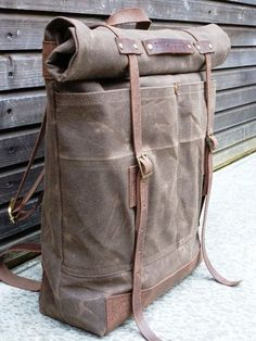 Waxed canvas rucksack/backpack with roll up top and waxed leather shoulder strap, handle and leather bottom $209.00, via Etsy.