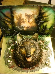 Wolf cake - Wolf Cake. I made this cake for my brother . He loves wolfs and asked me to make one for his 18th birthday.  Chocolate cake with vanilla buttercream and fondant. White chocolate and fresh strawberries for filling. Edible image and royal icing details for background.