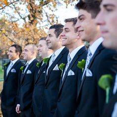 Joseph Abboud groomsmen tuxedos with berry boutonnieres (Laura Leigh Photo)
