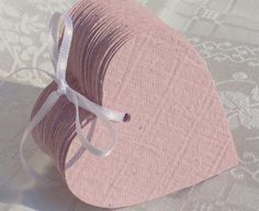 40 rosa Herzen aus handgeschöpftem Papier, Herzbuch von paperuli auf DaWanda.com; absoluter Hochzeits-Bestseller: zuerst gab es bei mir nur Herzanhänger, die Herzbuch-Idee (Kombi Tischkarte, Gästebuch) ist auf Kundenwunsch entstanden und seitdem erfolgreich im Sortiment! #MeinDaWandaLiebling
