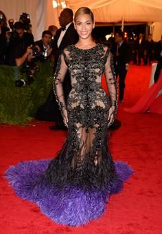 New mom Beyoncé steals the show in a stunning Givnechy couture sheer gown with a feathered purple hem. Wow!