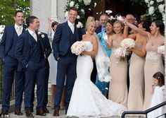 Family affair: The couples wedding party showered them with petals outside the church