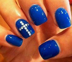 Diamond cross on blue