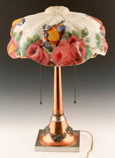 """PUFFY PAIRPOINT REVERSE PAINTED GLASS LAMP 1907 - Pairpoint puffy glass lamp, reverse painted  with flowers and butterflies, dated 1907,  marked on inside of shade.   Size: Shade;  14"""", Base (w/ shade); 21"""""""
