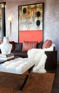 Chic living room with unique wall art [Design: CIH Design]