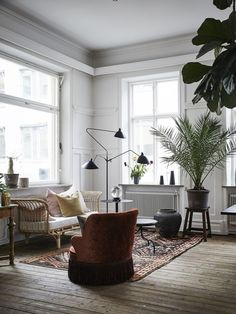 Love the green pot plants featured #StylishLounge