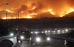 Los Angeles. October 13. Residents flee hillside homes during fast moving, windfire. c/oThe Telegraph
