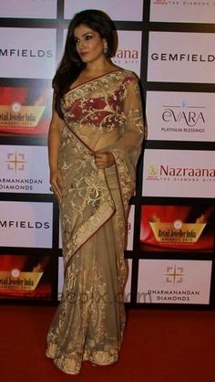 Actress Raveena tandon saree style at 11th Genfields & Nazrana Retail Jeweller India Awards 2015. She wore transparent embroidery net saree with pink r