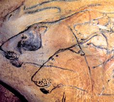 """Big Cats"" from the Chauvet cave in Ardeche, France.  The caves contain hundreds of figures, many rhinos and big cats.  Dated at 30,000 bce"