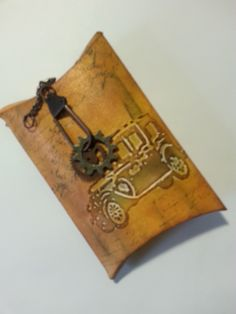 Sizzix pillow box die with Tim Holtz embossing folder and embellishments.