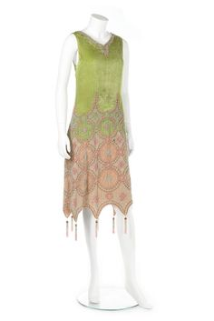 Callot Soeurs couture beaded acid green velvet orientalist dress, circa 1923. A Callot Soeurs couture beaded acid green velvet orientalist dress, circa 1923. un-labelled, the lower skirt of pale pink velvet embroidered and beaded in roundels, the scalloped hem with tasselled points, bust 81cm, 32in For a similar Callot Soeurs orientalist velvet dress, see the Metropolitan Museum accession number: 2009.300.3187..