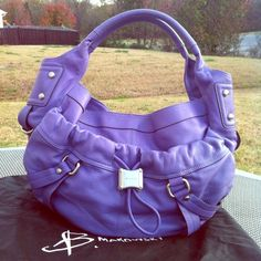 """B. Makowsky   Beautiful soft leather, dark lavender - silver hardware shoulder bag in Excellent condition. Approx measurements :  15"""" x 12""""  x 3"""" with a 9"""" strap drop. There is a middle zipper that divides the main pocket (magnetic closure). Also an open pocket on the outside with a magnetic closure. Dust bag included. 25% off 2+ bundles!! b. makowsky Bags Shoulder Bags"""