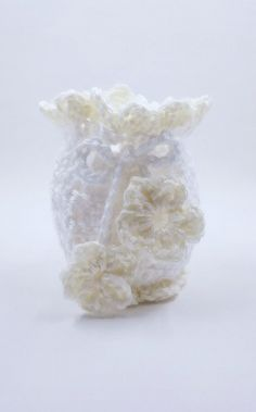 This listing is for a dainty hand-crocheted sashay or potpourri bag. Could also be used as a small gift bag or jewelry holder. Features: - Colors-Crisp white and cream - Crocheted flower tie closure a