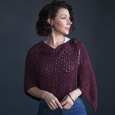 Wine Country Beginner Knit Shawl: While we love both the stitch pattern and the merlot coloring , the coolest thing about this shawl is its versatility; the shape and ties on this pattern allow for multiple different wearing styles.