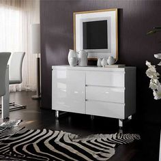 Sydney Sideboard, Sleek elegant design finished in a beautiful high gloss white, made from high quality MDF with chromed metal feet, the sideboard features one cupboard with one shelf inside and 3 ...