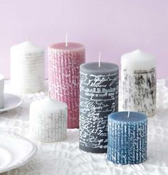 Stamping paint onto candles using clear stamps - what a cool idea,